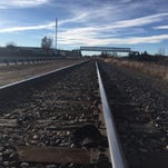 Colorado woman gets away unharmed after train rolls over her