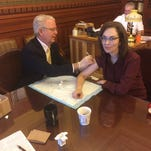 Pharmacist legislator gives shots to fight flu at Iowa Capitol