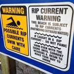Rip current warning signs are not to be taken lightly by swimmers and surfers.