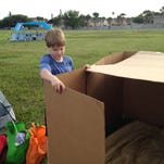 Sara Paulson's son sets up his temporary shelter during Box City on April 17 in Indialantic. The event raised money for the nonprofit Family Promise of Brevard. Sara Paulson/FLORIDA TODAY