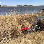 A motorcycle rests near Deadman Lake east of Fort Collins on Saturday. The rider was taken to the hospital with non-life-threatening injuries
