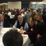 Potential Republican presidential candidate Carly Fiorina, center, talks a supporters during a Friday night spaghetti dinner at Clear Creek Amana High School in Tiffin.