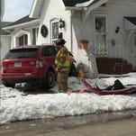 A car crashed into a home at 28th and South streets on March 5, 2015.