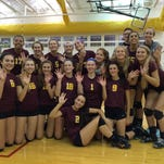 Seaholm's volleyball players give the 'high-five' after winning the Marian Invitational on Saturday – their fifth tournament championship this season.