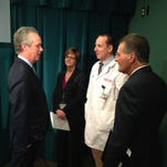 Mayor Greg Fischer, left, talks to, from left, newly appointed emergency services director Debbie Fox, new EMS medical director Dr. Raymond Orthober, and chief of public services Doug Hamilton after announcing he was combining the city's three emergency management agencies and appointing Fox to lead them on Friday.