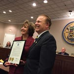 Sen. Joe Pennacchio presents a proclamation from the New Jersey Legislature honoring Parsippany Library Director Jayne Beline for 25 years of service during the Parsippany-Troy Hills Council meeting on Tuesday, Feb. 24