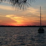 """Sunset shot taken from the Blue Angel Recreational Park by Matt Holmes. """"The sailboat in the picture was sailed all the way up from the Keys by an old friend of mine."""""""