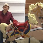 Hyde Park resident William Strollo, 85, handcarved this carousel horse out of basswood. It weighs approximately 200 pounds and took him about a year and a half to carve. It is on display at Dutchess County Fair in Rhinebeck through Aug. 24.