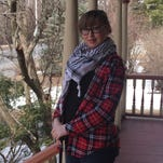 Sarah Weyant on the porch of her Academy Street home in the City of Poughkeepsie.