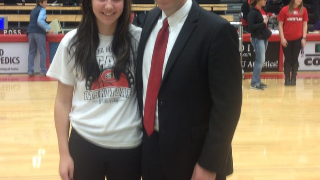 Annandale senior Brittany Reimer poses with her father Matt, the head men's coach at St. Cloud State, after the Huskies game against Sioux Falls this past Saturday at Halenbeck Hall.