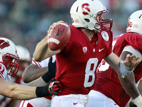Wisconsin's Tyler Dippel tries to sack Stanford quarterback
