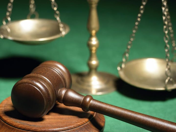 Five township police were indicted Friday by a grand
