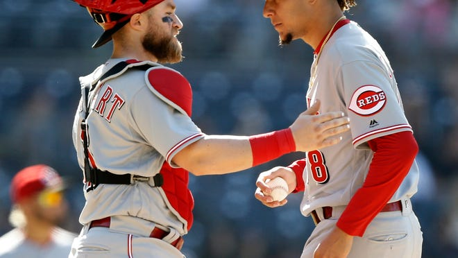 Cincinnati Reds catcher Curt Casali, left, talks to starting pitcher Luis Castillo after the San Diego Padres loaded up the bases during the fifth inning of a baseball game in San Diego, Sunday, June 3, 2018. (AP Photo/Alex Gallardo)