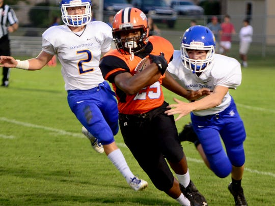 South Gibson County's CJ Sharp outruns Jackson Christians' Collin Cantrell and Hayden Love during their game, Friday.