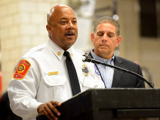 Lansing Fire Chief Randy Talifarro speaks during a