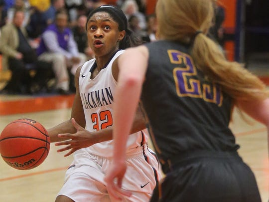 Blackman's Crystal Dangerfield (32) drives toward the