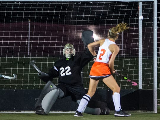 Palmyra goalie Cheyenne Sprecher knocks away a Lower