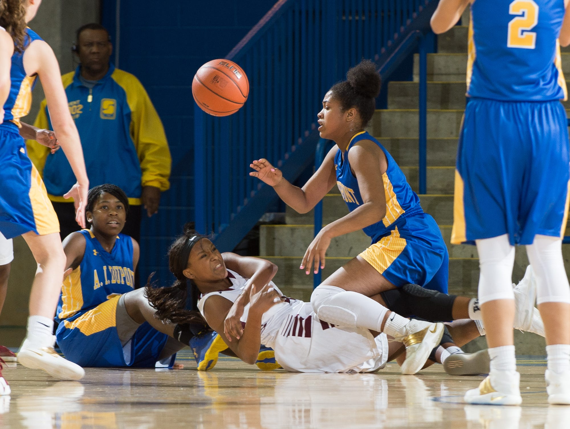 Ball gets loose during the quarterfinals of DIAA Girls Basketball Tournament at the University of Delaware.