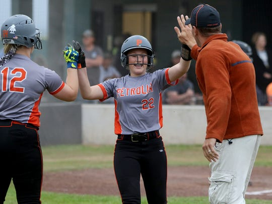 Petrolia's Kelsie Whalen gets high fives from Kaylee King and coach Heath Aldrich after scoring against Archer City Tuesday, March 28, 2017, in Archer City. The Lady Pirates defeated the Lady Cats 3-2.