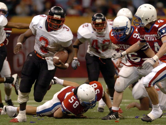 Northside High School  Keiland Williams(3) breaks through the John Curtis line,Friday Dec. 11, 2004, during the Class4A LHSAA Football Championship game at the Superdome in New Orleans La.. Photo by Brad Kemp
