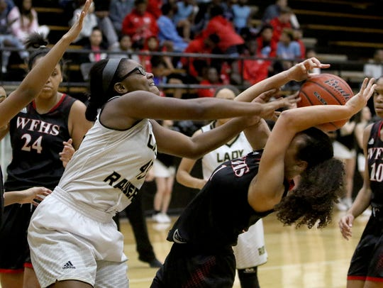 Rider's Laeschelle Wright (left) is the Lady Raiders' lone returning starter from last season.