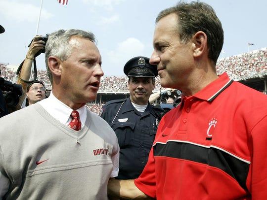 Ohio State's coach Jim Tressel, left, and Cincinnati's
