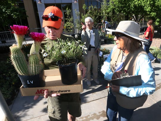 Don Foster, left, of El Paso showed Cheryl Garing his choices in native plants during the FloraFest 2018 plant sale outside the Undergraduate Learning Center on the UTEP Campus.