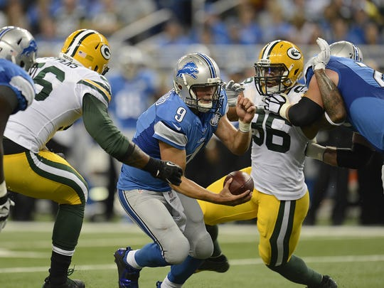 Green Bay Packers' Mike Neal (96) and Julius Peppers (56) pressure Detroit Lions quarterback Matthew Stafford (9) in the second quarter during Sunday's game at Ford Field in Detroit. Evan Siegle/Press-Gazette Media/@PGevansiegle