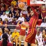 Iowa State's Matt Thomas, left, and Monte Morris double team Illinois' Khalid Lewis in the first half of an NCAA college basketball game during the Emerald Coast Classic in Niceville, Fla., Saturday, Nov. 28, 2015.