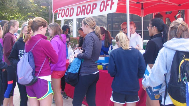 Students rally to help with more than 2,300 pounds of food donations collected at Sunday's Run for Rutgers Against Hunger 5K and 1-mile Fun Walk.