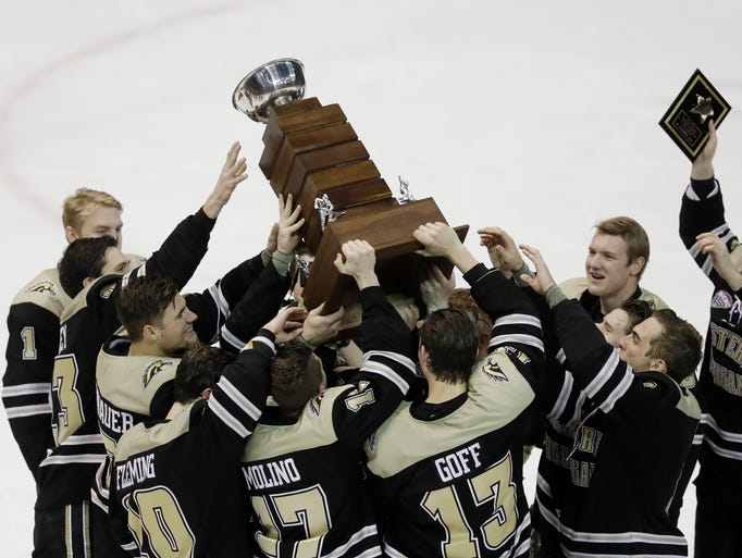 The Western Michigan team holds the winner's trophy