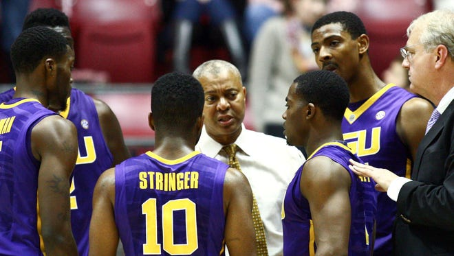 LSU Tigers head coach Johnny Jones talks to his team during the game against the Alabama Crimson Tide at Coleman Coliseum.