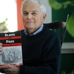 "Author Kirk Mariner speaks about his recent book ""Slave and Free on Virginia's Eastern Shore"" as he sits in his home office surrounded by books and reference materials in Onancock."