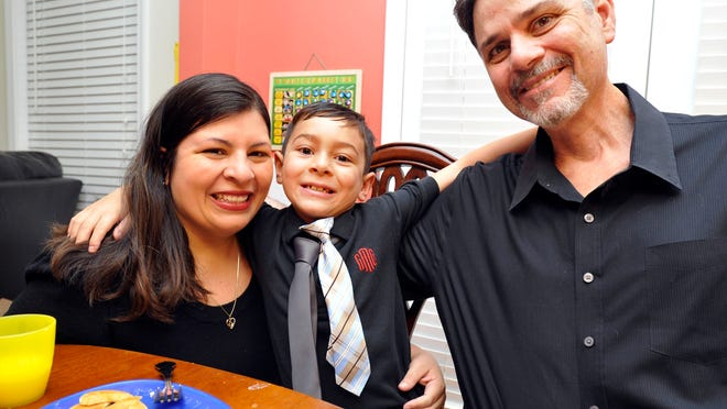 Marisela Martinez-Cola, a lawyer living in an Atlanta suburb with her husband, Greg, and their 7-year-old son, David, prepare for a typical school and workday Tuesday.