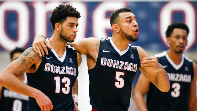 Gonzaga Bulldogs guard Josh Perkins (13) and Gonzaga Bulldogs guard Nigel Williams-Goss (5) speak with the coach during the second half of the game against the St. Mary's Gaels at McKeon Pavilion.