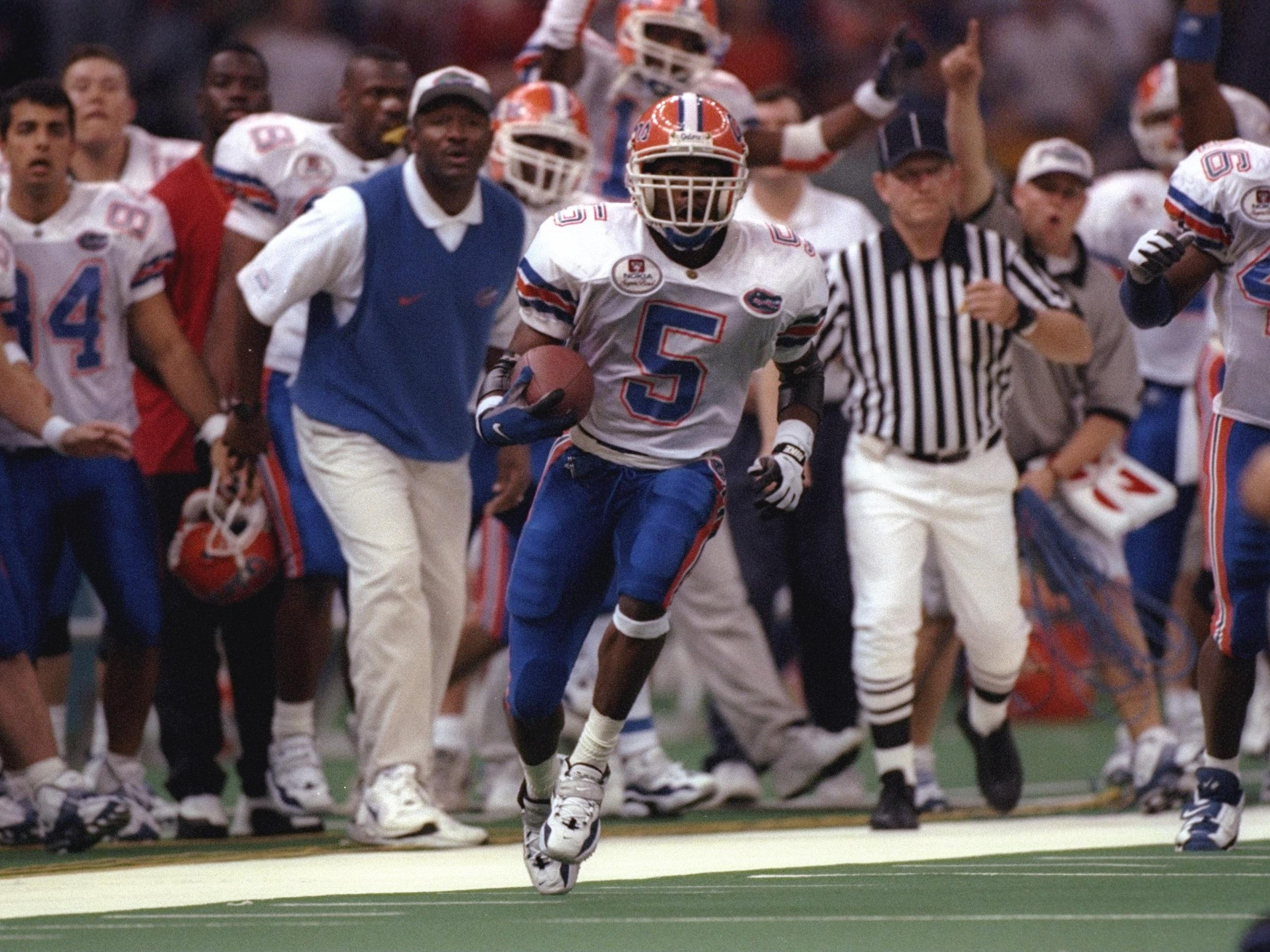Florida wide receiver Jacquez Green gets up the sideline on a punt return during the Gators' 52-20 win over No. 1 FSU in the 1997 Sugar Bowl, giving Florida a national championship.