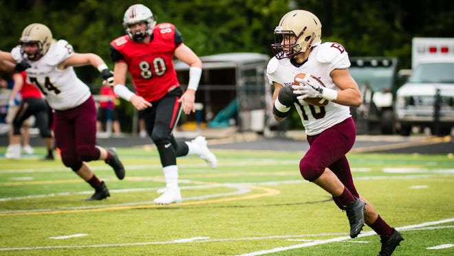Brebeuf Jesuit's Noah Delumpa with the ball against Cardinal Ritter.