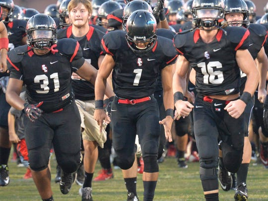 Stewarts Creek is off to a 2-1 start behind quarterback Chris Dye (16). The Red Hawks play at La Vergne on Friday.