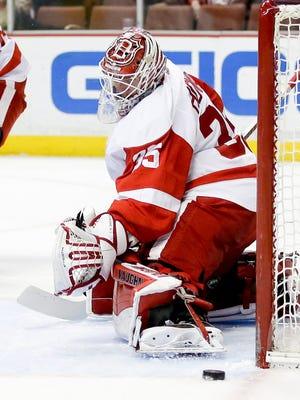 Detroit Red Wings goalie Jimmy Howard blocks a shot against the Anaheim Ducks during the second period of an NHL hockey game in Anaheim, Calif., Monday, Feb. 23, 2015.