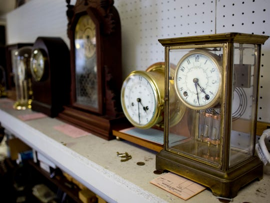 Dozens of clocks in for repairs line the walls in the workshop Wednesday, October 28, 2015 at Moshers Jewelers in Port Huron.