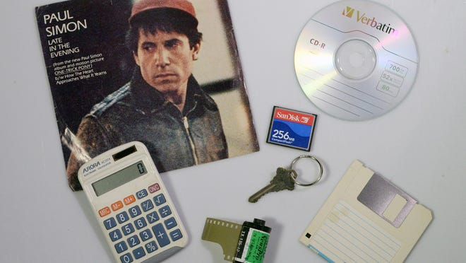 A 45-rpm single, a calculator, car keys, film canisters and once-trendy digital media — all victims of fast-changing times.