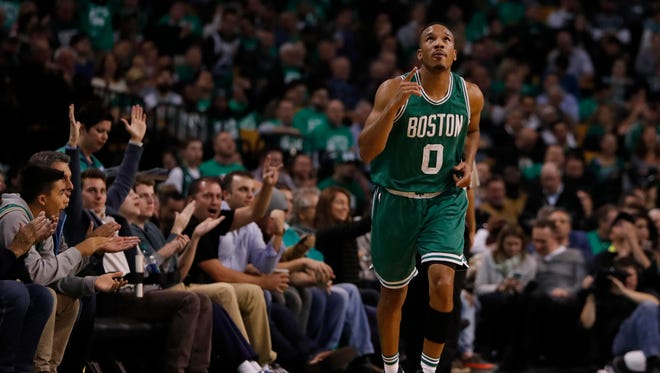 Boston Celtics guard Avery Bradley (0) reacts after his three point basket against the Brooklyn Nets in the second half at TD Garden. The Celtics defeated the Brooklyn Nets 122-117.