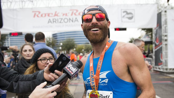 Thomas Puzey (1), from Flagstaff, smiles after winning the 14th Rock 'n' Roll Arizona Marathon in Tempe, January 15, 2017.