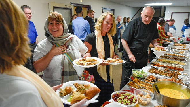 Mosque members welcomed community members to join them for iftar, the meal Muslims eat after sunset to break the daily fast Muslims observe during the holy month of Ramadan on Thursday, June 23, 2016, at the Islamic Center in St. Cloud.
