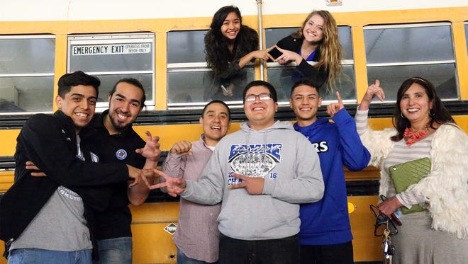 A group of seniors enrolled in the business magnet program at Bowie High School had planned to convert a donated district school bus into a food truck, but now will buy an already equipped food truck instead. Those involved are, from left, Sergio Marrufo, Joseph Gutierrez, teacher Victor Martel, Sisco Gonzalez, Andy Valdez and teacher Rochelle Rosas. Sophia Morales and Veronica Rodriguez are at top.