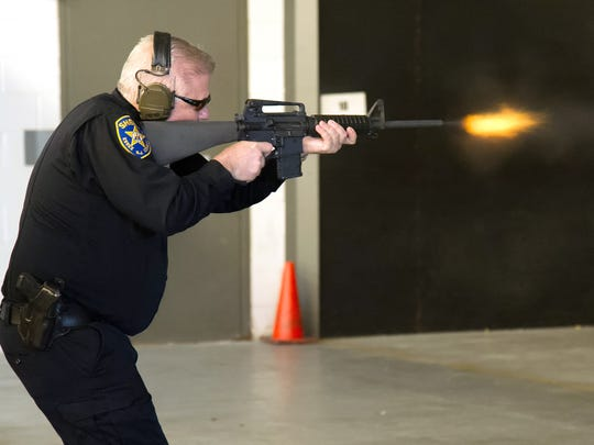 Captain Peter Corbo, Rangemaster of the Essex County Police Academy, fires an AR-15 assault rifle in a demonstration at the academy in Cedar Grove on Monday, March 5, 2018.