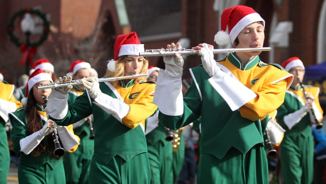 The Gallatin High School Marching band flute section plays in the Gallatin Christmas parade on Sat. Dec. 10, 2016.