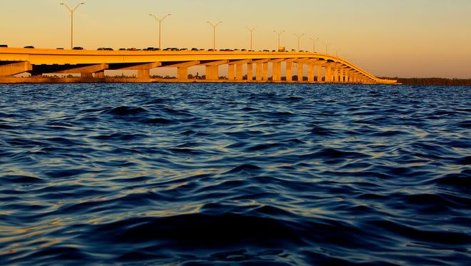A Fort Myers to Cape Coral view of sunrise over the Midpoint Memorial Bridge on Thursday. The bridge opened Oct. 19, 1997.
