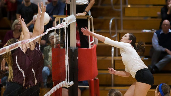 Evangelical Christian School's Samantha Bebber, right, scores against First Baptist Academy during the Region 3A-3 volleyball final on Thursday at ECS in south Fort Myers. FBA beat ECS.