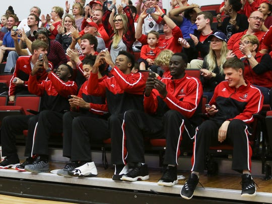 Austin Peay State University's basketball team takes photos of the screen with their phones as their bracket is shown during the NCAA tournament selection show on Sunday. No. 16 seed Austin Peay will play No. 1 seed Kansas on Thursday.